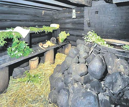 Атрибут бани по-чёрному — чёрные камни в печи